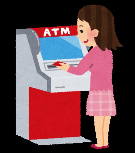 銀行やコンビニにある、ATM端末(現金自動預け払い機)を使っている女性